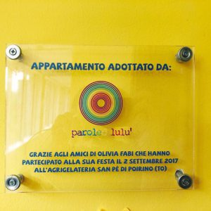 parole-di-lulu-appartamento-ugi-onlus-targa